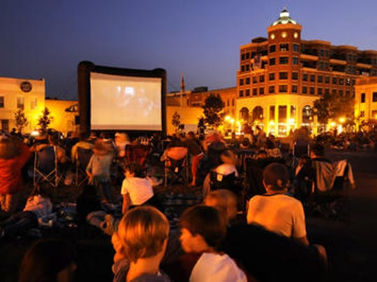 The 400 block of downtown Wausau is transformed into an outdoor theater in 2015 for the showing of the Goonies during the final Screen on the Green showing of the summer.