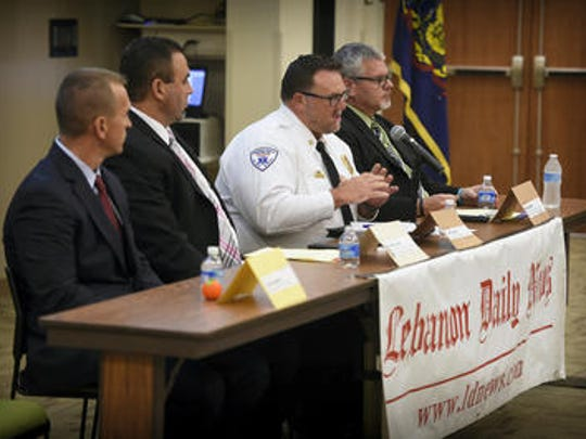 Panelists, from left, David Arnold, Lebanon County district attorney; Dr. Marc Bonin, medical director, emergency department, WellSpan and Good Samaritan Hospital; Bryan Smith, executive director of First Aid and Safety Patrol; and Jim Donmoyer, director of the Lebanon County Commission on Drug and Alcohol Abuse, address a forum on heroin and drug abuse at Harrisburg Area Community College in Lebanon on Sept. 17, 2015.