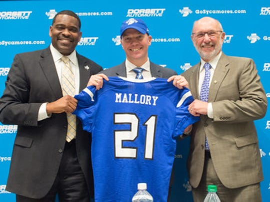 ISU director of athletics Sherard Clinkscales, left, and school president Daniel Bradley, right, introduced Curt Mallory as the new head coach of the Indiana State Sycamores on Wednesday. Curt Mallory is the son of IU's all-time winningest coach, Bill Mallory.