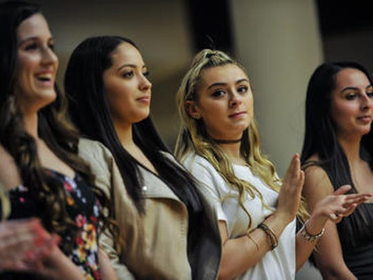 Members of the Middlesex County cheerleaders are introduced