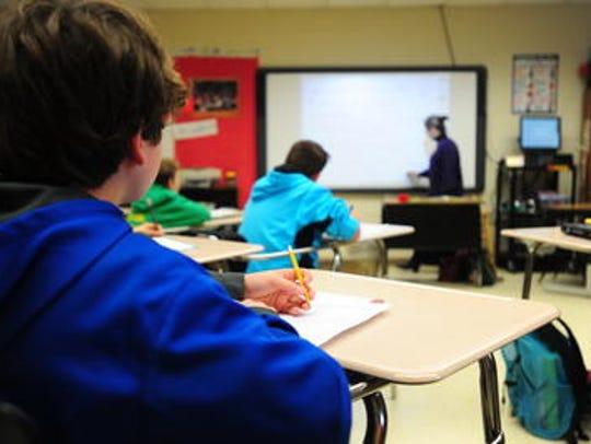 A teacher leads a lesson in a Lafayette Parish classroom.