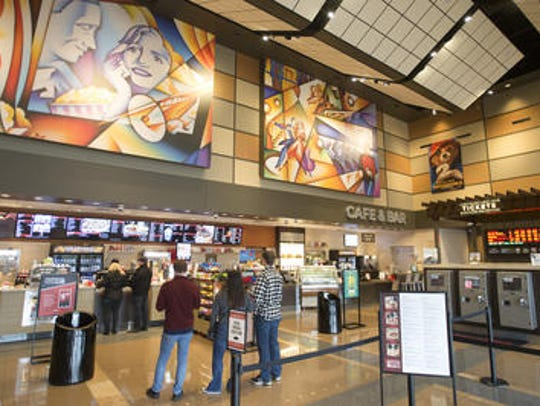 Moviegoers to the Cinemark XD theater in Fort Collins wait in line for concessions.
