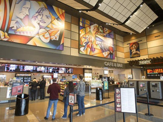 Movie goers at Cinemark XD in Fort Collins wait in line for concessions.