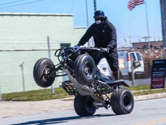 Francis Drummond pops a wheelie while riding an ATV in March 2018 in Wilmington.