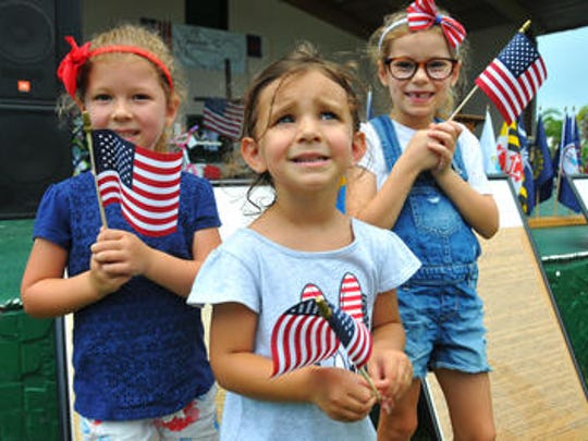"Brevard celebrated the Fourth of July on Wednesday, keeping on eye on ominous clouds to the west. At Wickham Park, hundreds showed up for the Jesus is the Key Church & Ministries ""Lifting Up God & Country"" celebration at the amphitheater. Standing by copies of the Constituion and Declaration of Independence are Madelyn Farney, Adalyn Peacock and Maya Farney, all with American flags."