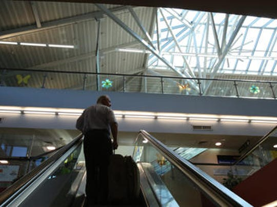 A traveler at the Westchester County Airport Aug. 19, 2014.