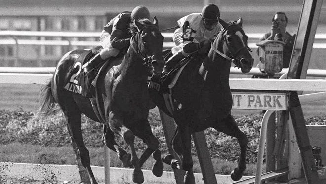 Affirmed, right, wins the Belmont Stakes in 1978 to complete the Triple Crown.