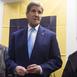 Secretary of State John Kerry speaks alongside refugees that have resettled in the United States during a visit to the International Rescue Committee in Silver Spring, Md. Wednesday.