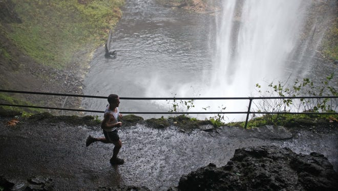 Runners take part in a previous Silver Falls full and half marathons at Silver Falls State Park.