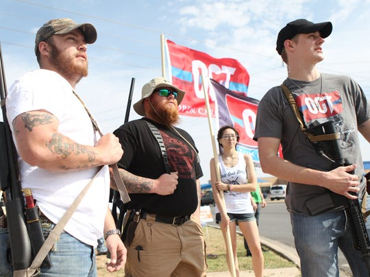 T.J. Holt, Kyle Carter and Tyler Benbow take part in an Open Carry Texas march in San Angelo, Texas in 2014.