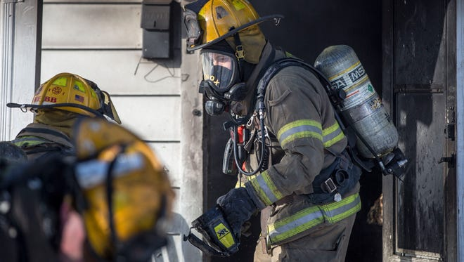 Firefighters attempt to put out a structure fire on Jan. 18 in the 2000 block of S. Rosemont Ave. after a kitchen fire spread to different portions of the house. No injuries were reported and only one person was home at the time of the fire.