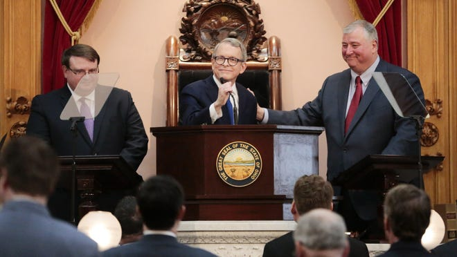 It was all smiles at Gov. Mike DeWine's State of the State address. Now, Senate President Larry Obhof (left) and House Speaker Larry Householder (right)are talking about budget disagreements.