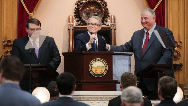 Flanked by Senate President Larry Obhof, R-Medina (left) and House Speaker Larry Householder, R-Glenford, Gov. Mike DeWine delivered his inaugural State of the State address in House chambers at the Statehouse on March 5, 2019. The coronavirus pandemic has indefinitely delayed DeWIne's second State of the State.