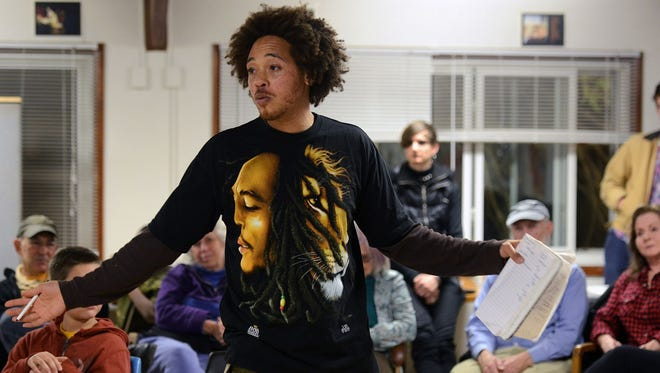 Jonathan Santos, one of the founding members of HoodTalk, helps set ground rules before opening the floor to discussion during the HoodTalk at Klondyke Homes.