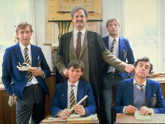 """Members of the Monty Python comedy group are shown in a scene from the 1982 film """"The Meaning of Life."""" Pictured in back from left are: Eric Idle, John Cleese and Graham Chapman. Front row from left are: Michael Palin and Terry Jones."""