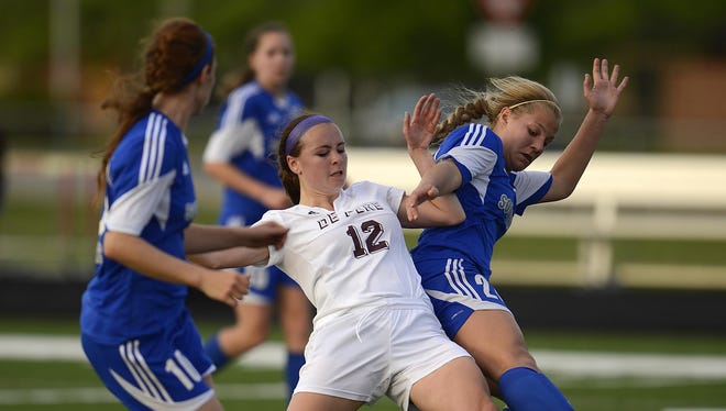 De Pere's Greta Arshem (12) battles Green Bay Southwest's Emily Burg (20) and Katie Rolefson (10) for the ball in the first half during a FRCC girls soccer game at De Pere High School in De Pere last week.