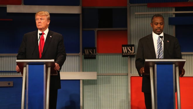 Donald Trump and Ben Carson take the stage at the start of the Republican presidential debate on Nov. 10, 2015, in Milwaukee.