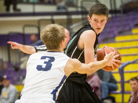 Yorktown's Bobby Smith attempts to shake Delta's defense