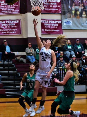 Eula's Megan Scott shoots a first-half layup as May's Yari Rodriguez (left) and Kaylee Harris (right) defend in a district game on Tuesday, Jan. 16, 2018 in Eula.