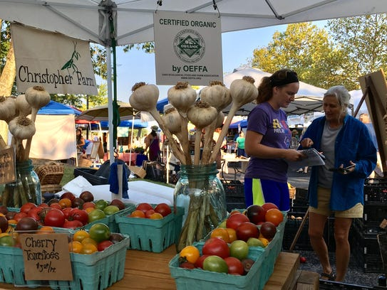 Wendy Carpenter, right, at the Minnetrista Farmers