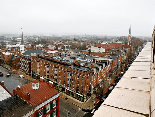 A view of York City is shown from the rooftop of The