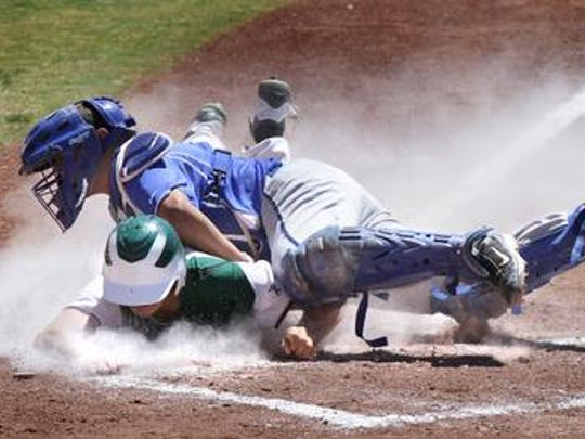 Montwood's Joe Galindo is called safe at home plate after knocking into Americas catcher Alex Medina during their playoff game in 2012 at Cohen Stadium.