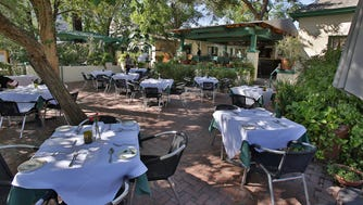 Have a romantic date night by dining on the patio at House of Tricks in Tempe.