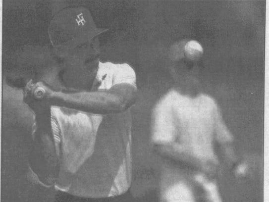 Florida High baseball coach John Hollenbeck hits infield