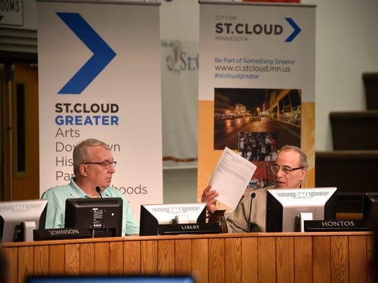 St. Cloud City Council member George Hontos, right, asks questions about the process that will be used to approve the city's comprehensive plan during a 2016 city council meeting at St. Cloud City Hall.