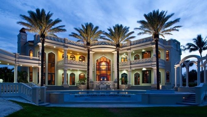 Palazzo Di Mare in Vero Beach is to be sold at auction Saturday. One stand-out feature of the 24,000-square-foot mansion is its opulent ceilings, including a master suite with a hand-painted ceiling mural (below), a formal dining room with a 14-karat gold ceiling and a full-service bar with a stained-glass ceiling.