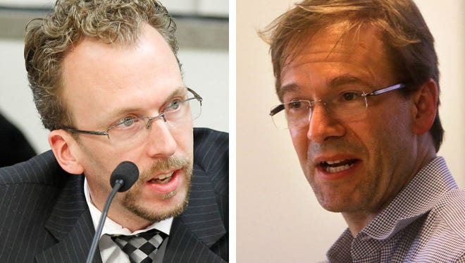 County Board Chairman Theodore Lipscomb Sr. (left) opposed a $30 increase in the county vehicle registration fee recommended by County Executive Chris Abele (right).