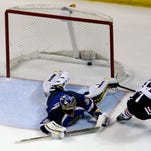 Chicago Blackhawks' Jonathan Toews, right, scores the game-winning goal past St. Louis Blues goalie Ryan Miller during overtime in Game 5 of their first-round playoff series Friday in St. Louis. The Blackhawks won 3-2.
