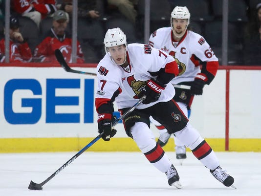 Ottawa Senators center Kyle Turris skates with the puck against the New Jersey Devils during the first period of an NHL hockey game, Tuesday, Feb. 21, 2017, in Newark, N.J. (AP Photo/Julio Cortez)