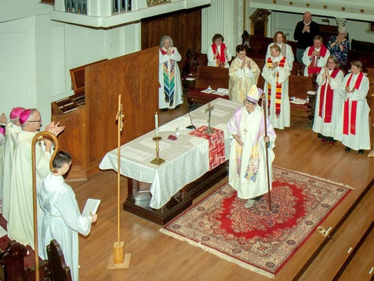 Pastor Denise Donato, of Mary Magdalene Parish in East Rochester, accepts the congratulations of fellow clergy members after her ordination as bishop of the Ecumenical Catholic Communion. The ceremony was held Friday at the Downtown United Presbyterian Church. Donato is the first woman ever ordained by the ECC as a bishop.