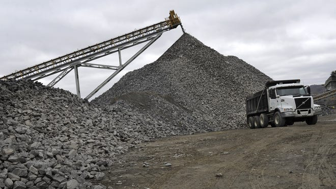 A dump truck waits to be loaded at the Rogers Group quarry off Whites Creek Pike.