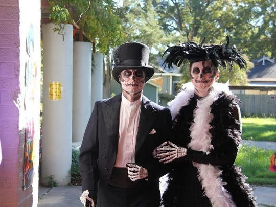 Some celebrants, such as Alan and Erin Berry seen here, go all out for the Day of the Dead celebration. .