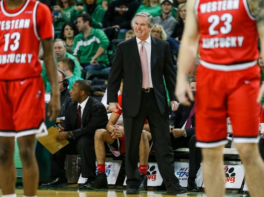 Western Kentucky head coach Rick Stansbury. center, talks with a player as they take on Marshall during an NCAA college basketball game Saturday, Jan. 6, 2018, in Huntington, W.Va. (Sholten Singer/The Herald-Dispatch via AP)