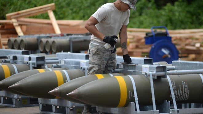 U.S. Air Force Senior Airman Jordan Kliewer, 36th Munitions Squadron inspector, marks weapons for stocking Sept. 7, 2017, at Andersen Air Force Base, Guam. Andersen recently received 1.5 million pounds of munitions that will increase the overall availability of day-to-day training assets and could be used to support war-fighting capabilities.
