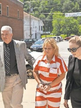Nancy Hogan enters the Madison County Courthouse for a 2015 court appearance.