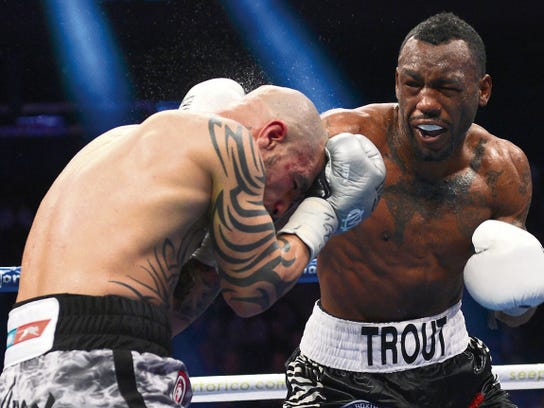 Austin Trout, right, lands a punch on Miguel Cotto of Puerto Rico during the eighth round of their WBA Superwelterweight title fight at Madison Square Garden in New York, Saturday, Dec. 1, 2012.