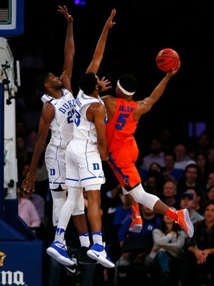 Devils forward Amile Jefferson (21) and guard Matt Jones (13) defend Florida guard KeVaughn Allen (5) during first half.