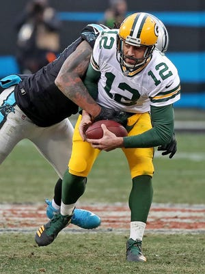 Green Bay Packers quarterback Aaron Rodgers (12) is sacked by Carolina Panthers defensive end Julius Peppers (90) on Sunday, Dec. 17, 2017 at Bank of America Stadium in Charlotte, N.C.