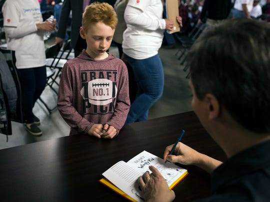 'Diary of a Wimpy Kid' author Jeff Kinney signs books at Worzalla Publishing in Stevens Point, Wis., April 11, 2018. Kinney made an appearance at the publishing company, which has published the series since its first installment in 2007, to celebrate 200 million copies sold worldwide.