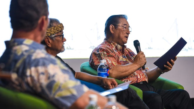 Former Gov. Joseph Ada, right, reflects on the history of the Guam Micronesia Island Fair during a press conference at the Guam Museum in Hagåtña on Thursday, April 26, 2018. Joining Ada are, Guam Visitors Bureau Executive Director Nathan Denight, left, and Mario Borja, Sakman Chamorro master carver.