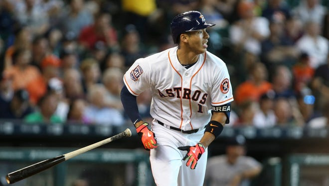 Houston Astros shortstop Carlos Correa (1) hits a double during the fourth inning against the New York Yankees at Minute Maid Park.