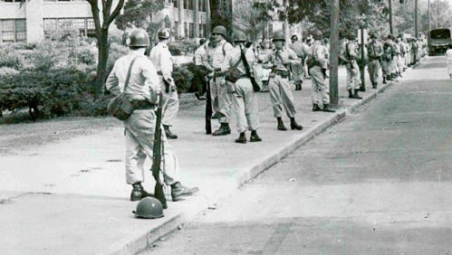 Arkansas Gov. Orval Faubus called out the National Guard to block nine black students from attending Central High School.