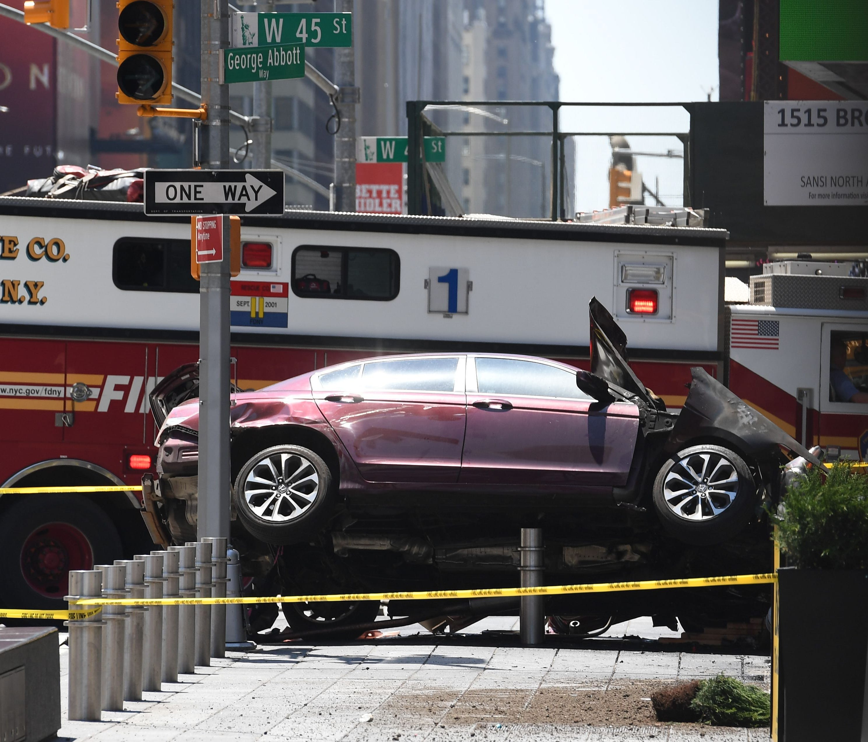 A wrecked car sits in the intersection of 45th and Broadway in Times Square on May 18, 2017, in New York City.