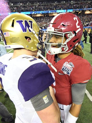 Alabama Crimson Tide quarterback Jalen Hurts (2) shakes hands with Washington Huskies quarterback Jake Browning (3) after the 2016 CFP semifinal at the Peach Bowl at the Georgia Dome.