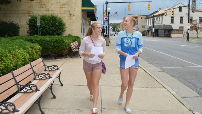 Tara Greter and Mara Winbigler walk through Uptowne Galion on Wednesday afternoon.