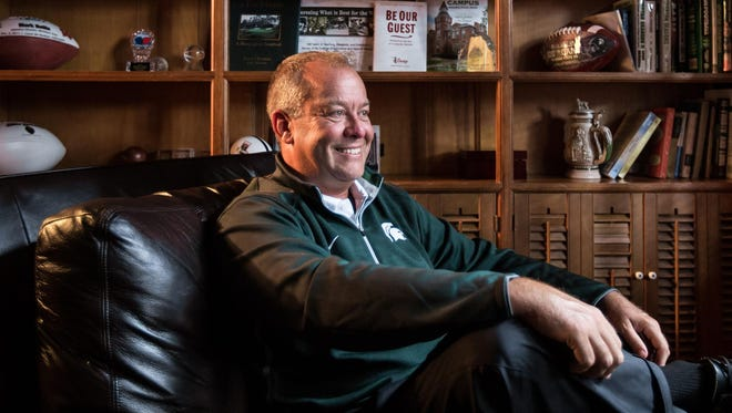 Michigan State athletic director Mark Hollis poses for a photo at his home in East Lansing on Aug. 20.